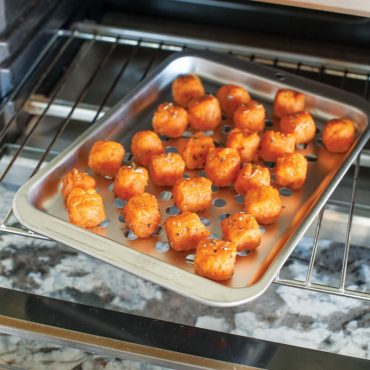 Baked tater rounds on compact pan in toaster oven