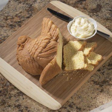 Baked cornbread half of turkey, sliced on board, butter in bowl
