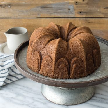 Baked spice cake on cake stand