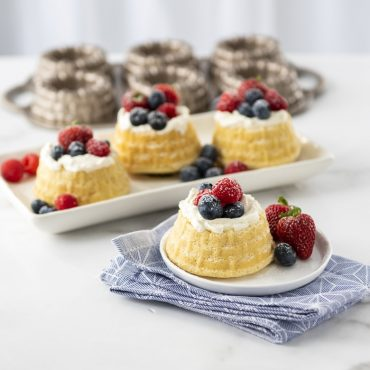 Baked shortbread baskets on platter, one plated, with pan in background