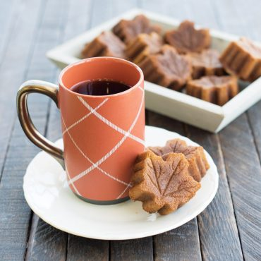 baked maple leaf cakes in serving dish, plate with two maple leaf cakes, cup of coffee