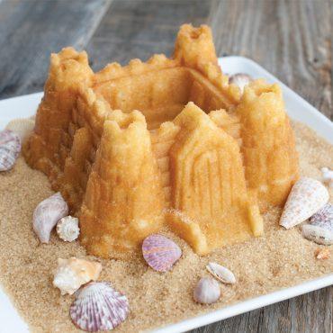 """Baked Castle Bundt on """"sand"""" brown sugar, sea shells as decoration"""