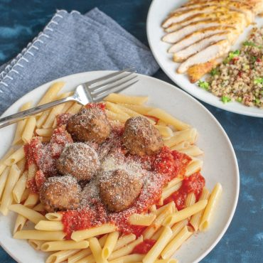 Close-up of Plate with pasta, spaghetti sauce and meatballs