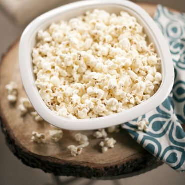 Close-up of popped popcorn in bowl on table