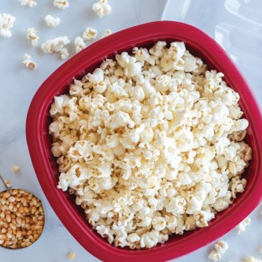 Top view popped popcorn in bowl