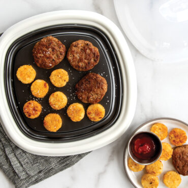 Sausage patties and potato coins cooked on QuickCrisp, some plated on side.