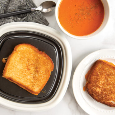 Grilled Cheese on QuickCrisp, one grilled cheese on plate with tomato soup.