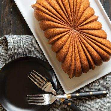 Baked Fluted Loaf cake on serving plate, two forks on plate