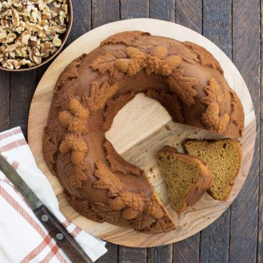 Top view of spice wreath cake on wood serving plate