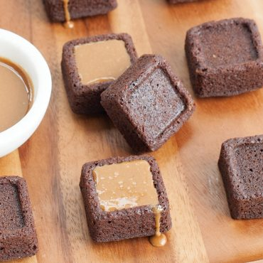 Close up of brownies with and without caramel filling