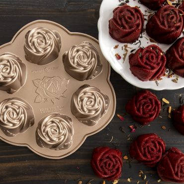 Pan on surface with baked red velvet rose cakes