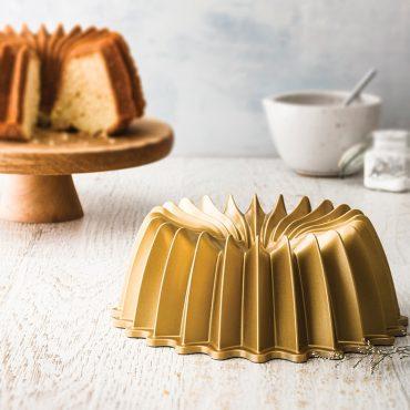 Brilliance Pan in focus, cut Brilliance cake in background