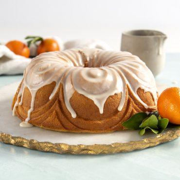 Angled shot of baked Chiffon Bundt with glaze.