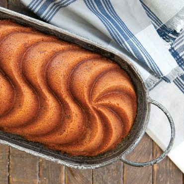Baked vanilla Heritage loaf cake on serving tray