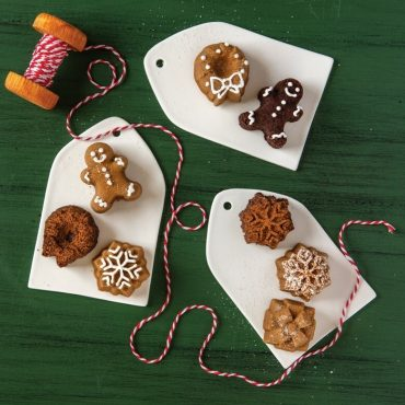 Variety of baked Holiday Teacake cakelet shapes, plain and decorated on serving plates