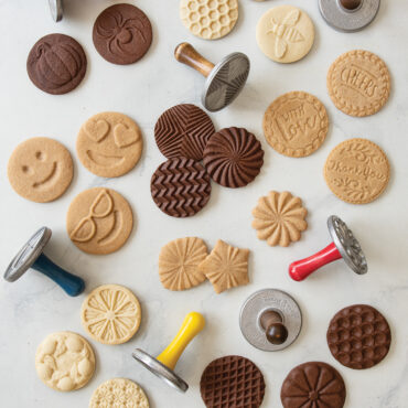 Baked stamped cookies on surface showcasing cookie stamp collection
