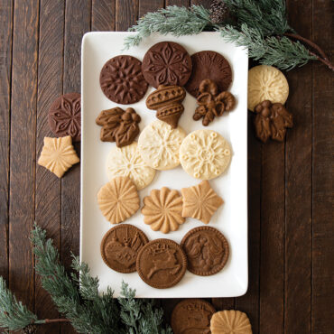 Baked gingerbread stamped cookie stamp group shot on plate, towel