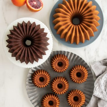 Baked Brilliance 10 Cup, 5 Cup, and Bundtlettes on platters