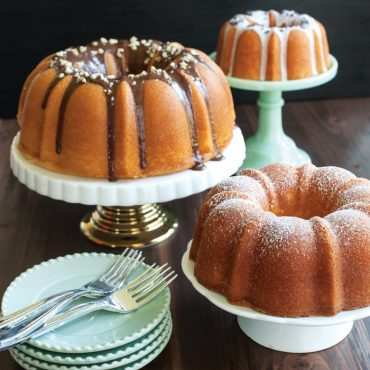 One of each size cake, variety of glazes, on cake stands