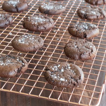 Baked chocolate cookies on cooling rack