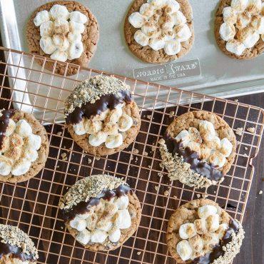 Baked s'more cookies on grid, sheet pan