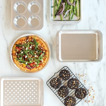 """Baked pizza on 9"""" Crisper, food on other compact products on marble surface."""