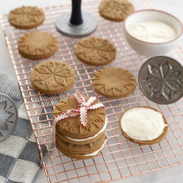Baked stamped cookies on copper grid, cookie stamps