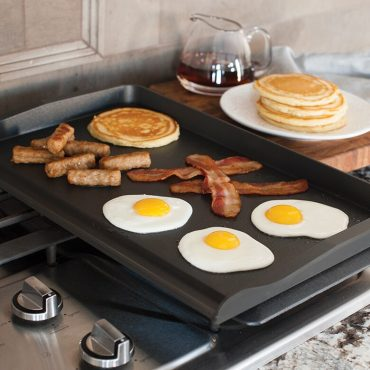 Double Backsplash Griddle with eggs, bacon, sausage, pancakes, on stove top