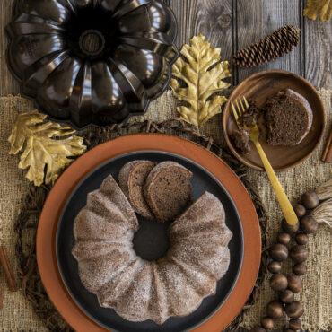 Sliced Cinnamon sugar Bundt on a platter, pan next to it