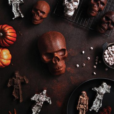 Halloween baked cakes collection including skull cakelets, skull cake, and skeleton cakes