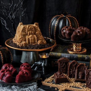 Halloween baking display, Haunted Manor Bundt cake, skull cakelets, and tombstone cakelets with decorations