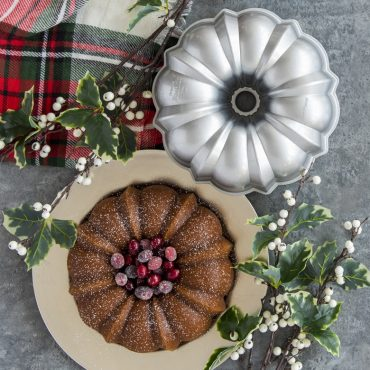 Baked Bundt with cranberries in the middle, with Bundt in background