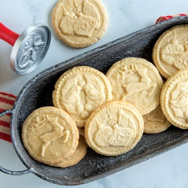 Baked Yuletide stamped cookies in tray