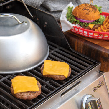Dome lid on grill with finished cheese burgers