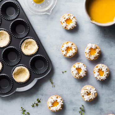 Baked tartlettes, in pan, on surface