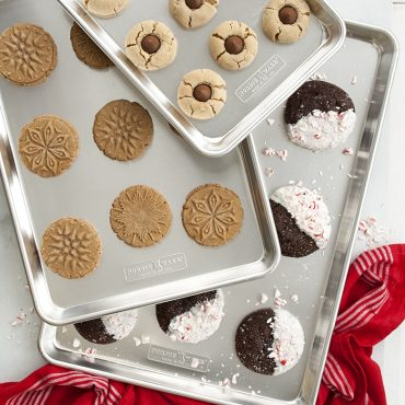 Variety of baked cookies on different size baking sheets in set