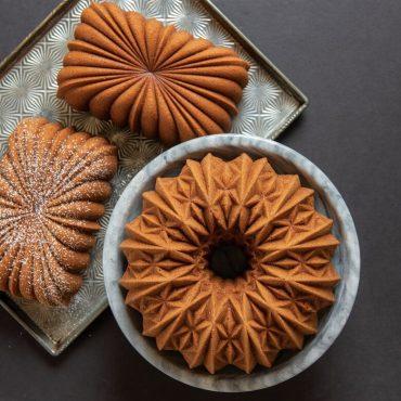 Baked Cut Crystal Bundt on platter, two loaf cakes on sheet pan next to Bundt