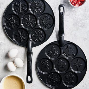 Holiday Pancake Pan and Snowflake Pancake Pan on surface with ingredients