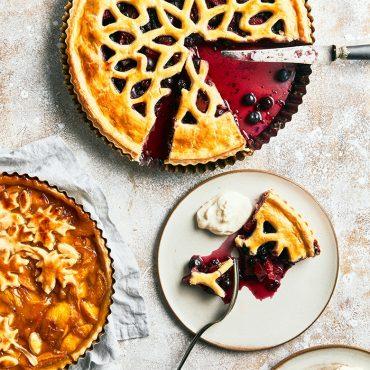 Cut baked lattice pie, piece on a plate.