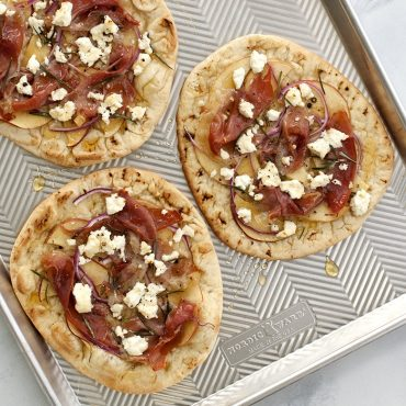 Flatbread pizzas baked on Prism sheet pan