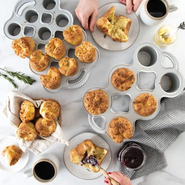 Popover group shot, both regular and petite pans, hands grabbing plates