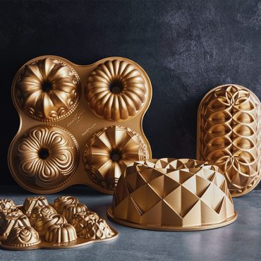 Jubilee Bundt Pan with other cake pans on surface
