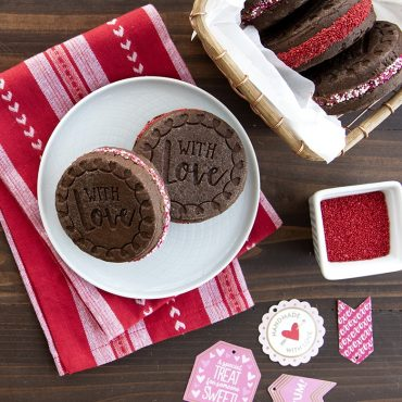 Baked chocolate stamped cookies sandwiches, Valentine's Day scene