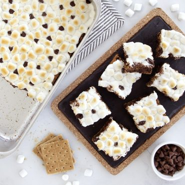 S'more Bars made in classic baking pan, cut pieces on a platter