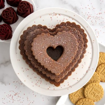 """Baked Tiered Heart Bundt cake with rosebud cakelets and """"With Love"""" baked stamped cookies- Valentine's scene"""