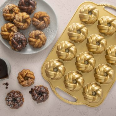 75th Anniversary Braided Mini Bundt® Pan with baked cakes