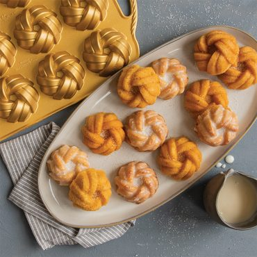 75th Anniversary Braided Mini Bundt® Pan with baked cakes and glaze