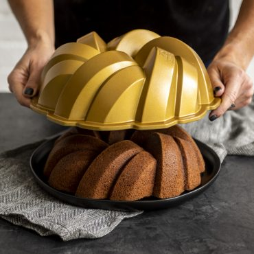 75th Anniversary Braided Bundt® Pan removing from baked cake
